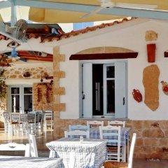 Отель Saronis Hotel Греция, Агистри - отзывы, цены и фото номеров - забронировать отель Saronis Hotel онлайн питание