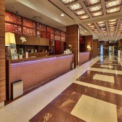Отель UNAHOTELS Expo Fiera Milano Италия, Милан - отзывы, цены и фото номеров - забронировать отель UNAHOTELS Expo Fiera Milano онлайн интерьер отеля фото 2