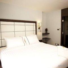 Отель Sukhumvit Suites Бангкок комната для гостей фото 2