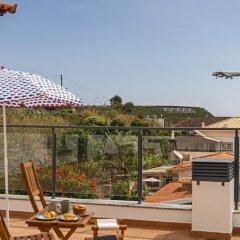Отель Apartamento Lobo Marinho Португалия, Санта-Крус - отзывы, цены и фото номеров - забронировать отель Apartamento Lobo Marinho онлайн балкон