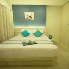 Отель The Palms Residence комната для гостей