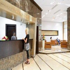 Отель Al Majaz Premiere Hotel Apartment ОАЭ, Шарджа - 1 отзыв об отеле, цены и фото номеров - забронировать отель Al Majaz Premiere Hotel Apartment онлайн интерьер отеля фото 3