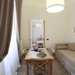 Апартаменты Santa Marta Suites & Apartments Лечче комната для гостей фото 4