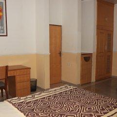 Отель Jacaranda Suites Нигерия, Калабар - отзывы, цены и фото номеров - забронировать отель Jacaranda Suites онлайн удобства в номере фото 2