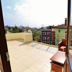 Апартаменты Camelot Apartment балкон