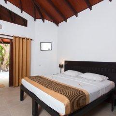 Отель Embudu Village Мальдивы, Велиганду Хураа - отзывы, цены и фото номеров - забронировать отель Embudu Village онлайн комната для гостей фото 3
