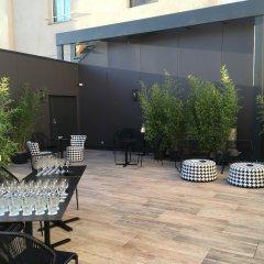 Qualys Le Londres Hotel Et Appartments Сомюр фото 3