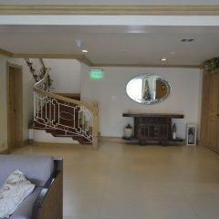 Отель Discovery Country Suites Филиппины, Тагайтай - отзывы, цены и фото номеров - забронировать отель Discovery Country Suites онлайн интерьер отеля