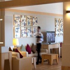 Отель Baia Chia - Chia Laguna Resort Италия, Домус-де-Мария - отзывы, цены и фото номеров - забронировать отель Baia Chia - Chia Laguna Resort онлайн интерьер отеля фото 2