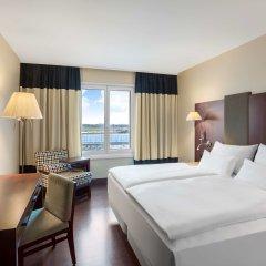 Отель Nh Wien Airport Conference Center Вена комната для гостей