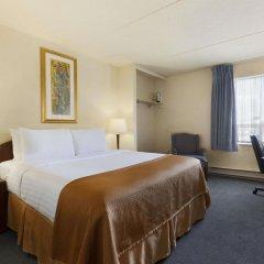 Отель Travelodge Calgary Macleod Trail Канада, Калгари - отзывы, цены и фото номеров - забронировать отель Travelodge Calgary Macleod Trail онлайн комната для гостей фото 2