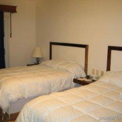 Отель Petit Lafitte комната для гостей