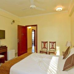 Отель Crystal Beach Inn Мале удобства в номере