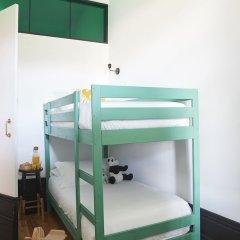 Отель Cocorico Luxury Guest House Порту сейф в номере