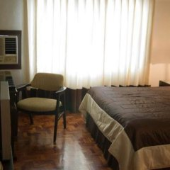 Отель El Rico Suites Филиппины, Макати - отзывы, цены и фото номеров - забронировать отель El Rico Suites онлайн сейф в номере