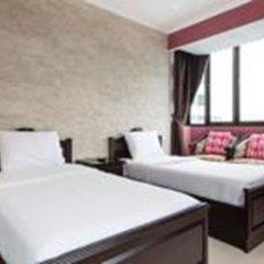 Отель Omni Tower Syncate Suites Бангкок комната для гостей фото 4