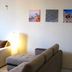 Апартаменты Lakshmi Great Apartment Afanasievsky Москва комната для гостей
