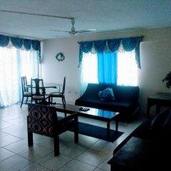 Отель Beach Side Condos at Turtle Beach Towers Ямайка, Очо-Риос - отзывы, цены и фото номеров - забронировать отель Beach Side Condos at Turtle Beach Towers онлайн комната для гостей фото 2