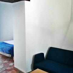Frenteabastos Hostel & Suites удобства в номере фото 2