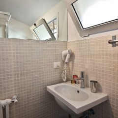 Отель Pinzochere Mansarda ванная