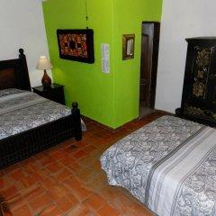 Hotel Rosa Morada Bed and Breakfast сейф в номере