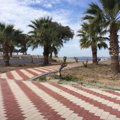 Geyikli Grand Resort Otel Турция, Тевфикие - отзывы, цены и фото номеров - забронировать отель Geyikli Grand Resort Otel онлайн пляж фото 2