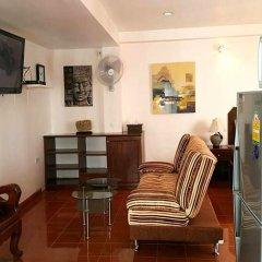 Отель Richman Poorman Guesthouse в номере