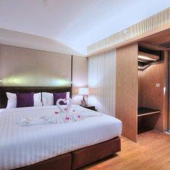 Отель Arcadia Suites Bangkok Бангкок комната для гостей