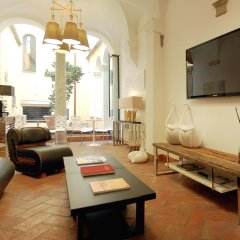 Апартаменты Navona Luxury Apartments комната для гостей