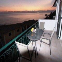 Отель Corfu Glyfada Menigos Resort балкон