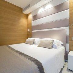 Отель Metropol Ceccarini Suite Риччоне комната для гостей фото 20