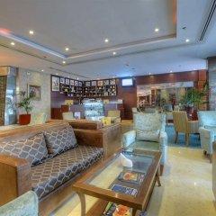 Отель Golden Tulip Al Barsha интерьер отеля фото 2