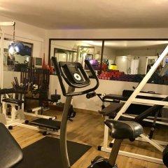 Отель Ducassi Suites Rooftop Pool Beach Club & Spa фитнесс-зал