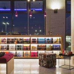 Отель Moxy Vienna Airport Австрия, Швехат - 6 отзывов об отеле, цены и фото номеров - забронировать отель Moxy Vienna Airport онлайн интерьер отеля
