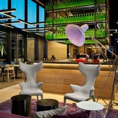 Отель YOTEL Singapore Orchard Road гостиничный бар фото 2