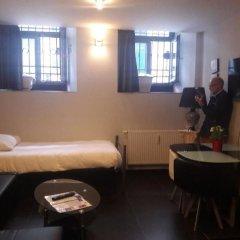 Отель Residence Marie-Thérese Бельгия, Брюссель - отзывы, цены и фото номеров - забронировать отель Residence Marie-Thérese онлайн комната для гостей фото 3