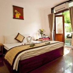 Отель Flower Garden Homestay Хойан комната для гостей фото 2