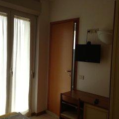 Hotel Apogeo удобства в номере