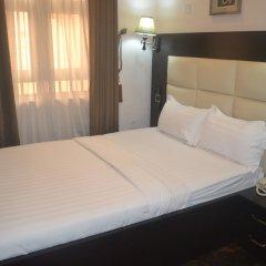 Отель Mac Dove Lounge & Suites ltd комната для гостей