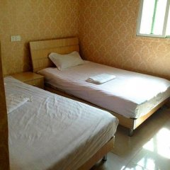 Апартаменты Xiamen Yiqing Apartment Сямынь комната для гостей фото 4