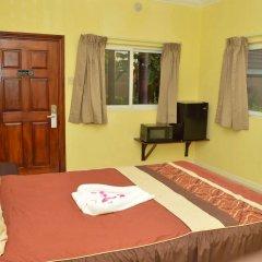 Отель Donway, A Jamaican Style Village Ямайка, Монтего-Бей - отзывы, цены и фото номеров - забронировать отель Donway, A Jamaican Style Village онлайн комната для гостей фото 4