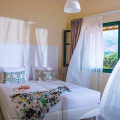 Kristalli Hotel Apartments комната для гостей