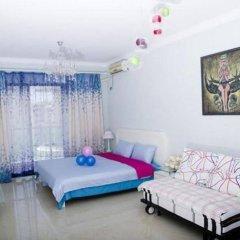 Апартаменты Sanya Haimengqingyuan Holiday Apartment комната для гостей фото 4