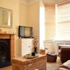Отель 1 Bedroom Apartment Near Clapham Великобритания, Лондон - отзывы, цены и фото номеров - забронировать отель 1 Bedroom Apartment Near Clapham онлайн комната для гостей фото 4