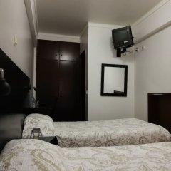 Отель Maciel сейф в номере