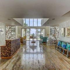 Отель Costa Atlantica Beach Condos Доминикана, Пунта Кана - отзывы, цены и фото номеров - забронировать отель Costa Atlantica Beach Condos онлайн интерьер отеля