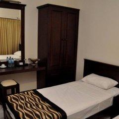 Отель Cafe Aroma Inn удобства в номере