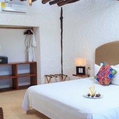 Отель Las Nubes de Holbox сейф в номере