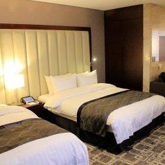 Отель The MVL Goyang сейф в номере