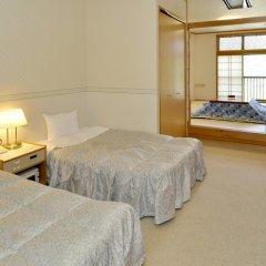 Отель Miyagawa Onsen Hida Manga Okoku Такаяма комната для гостей